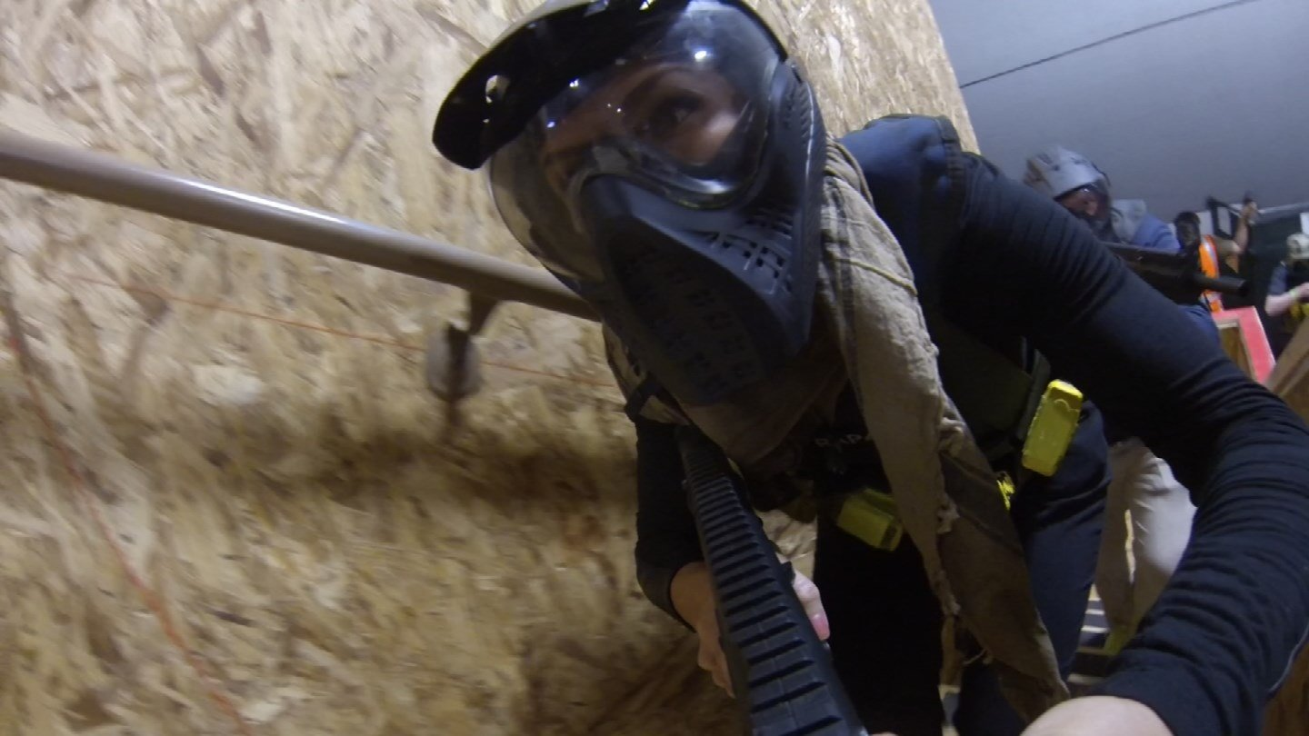 Participants pretend they are part of a special tactics team at TacVille's first Navy SEAL Experience (Source: KPHO/KTVK)