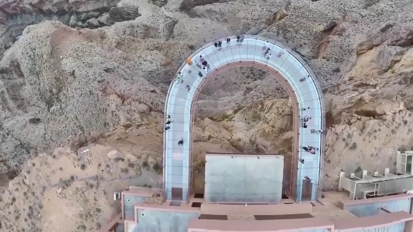 Visitors to Skywalk are suspended above the canyon. (KTVK)