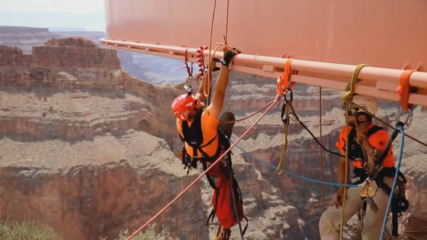 The workers wear elaborate harnesses. (KTVK)