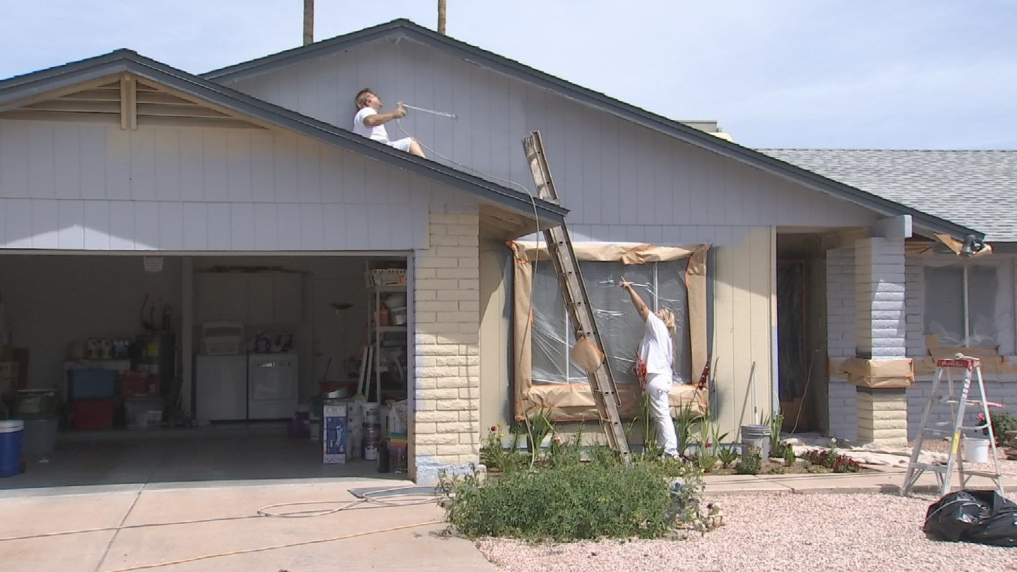 A local business steps in to help paint a couple's home in Glendale (Source: KTVK)