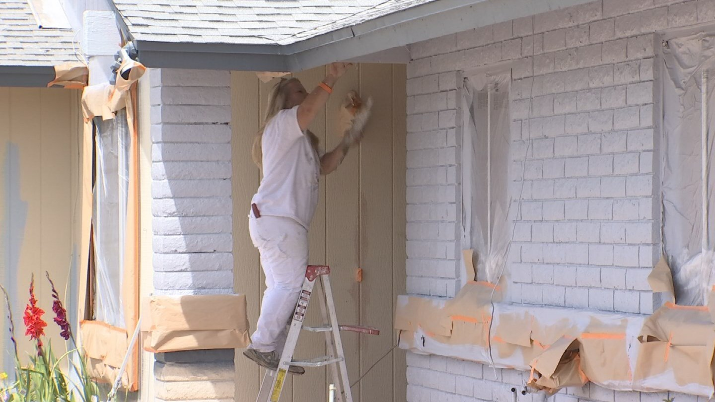 A painting company painted a Glendale couple's home for free (Source: KTVK)