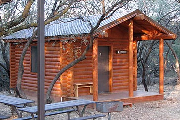Camping Cabins, available for rent, feature picnic tables, grills, and a community fire pit.  (Source: Arizona State Parks)