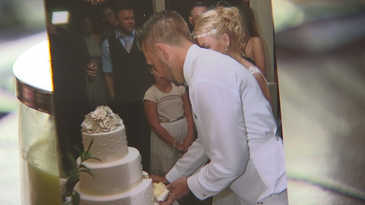 The family says they're not happy with many of the photographs they received. For example, they say you can't see the faces of Mandi and Joshua while they're cutting their cake. (Source: 3TV)