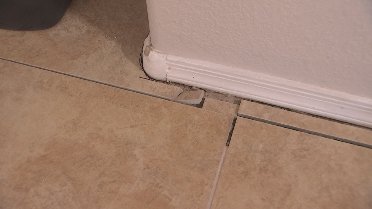 Many of Flowers' tiles aren't even grouted or sealed around the baseboards. (Source: KPHO/KTVK)