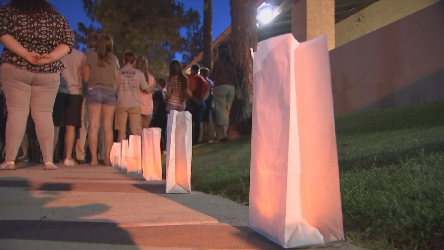The sidewalks surrounding the school were lined with luminaries. (Source: KPHO/KTVK)