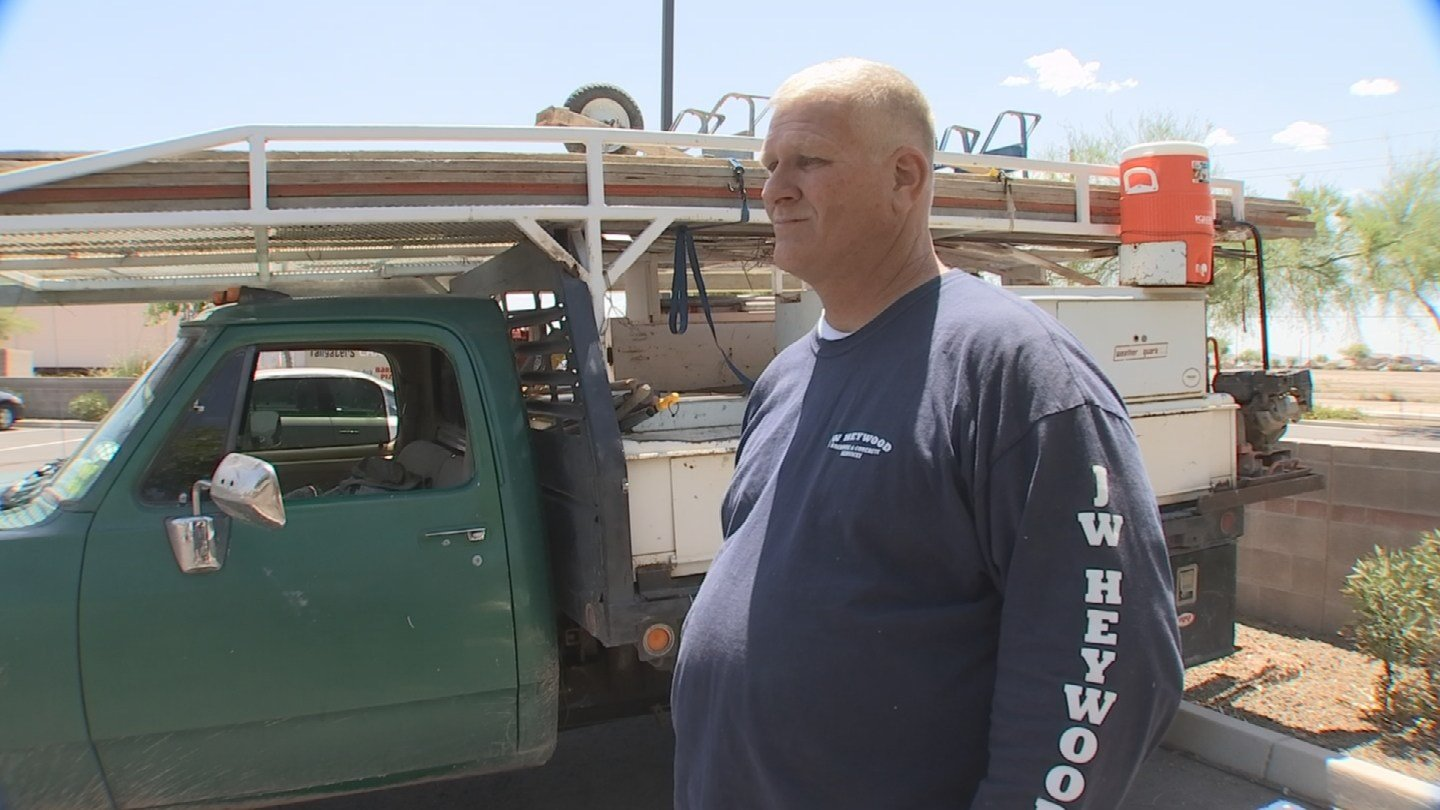 The contractor, John Heywood, said he offered to repair the work but claims Fisher is being unreasonable. (Source: KPHO/KTVK)