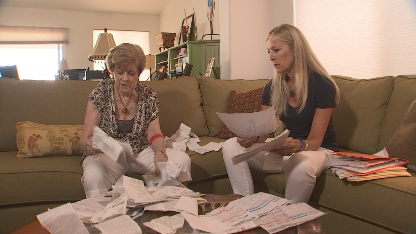 Eileen had a box of receipts from all the wire transfers she completed for the scammers. (Source: KTVK)