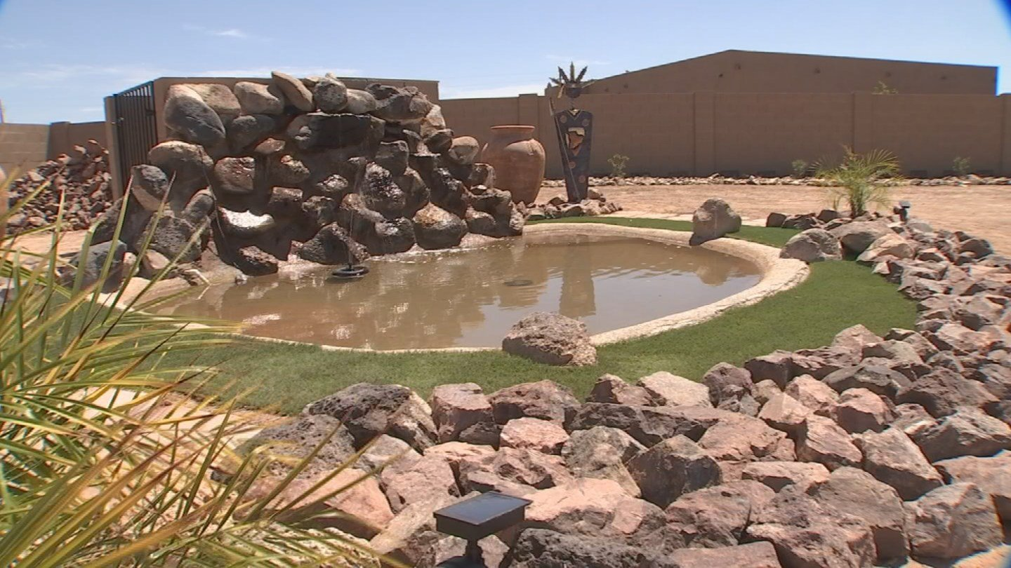 Not only did Trinity Turf and Landscape get the waterfall running and looking good, but the company also dressed it up by adding artificial grass and a border around the pond at no extra charge. (Source: 3TV)