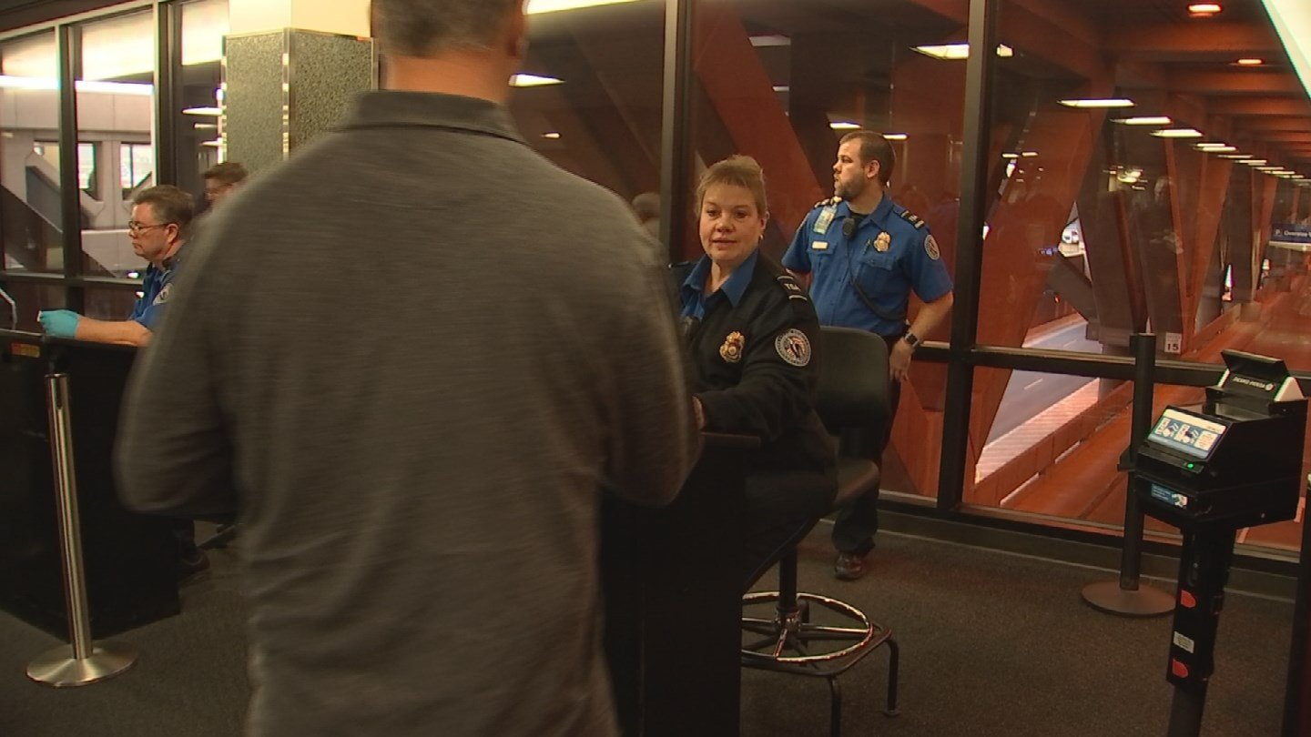 Participants in the Pre-Check program don't have to take off their belts or shoes. (Source: KPHO/KTVK)