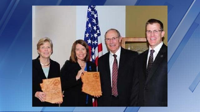 "Elizabeth ""Betsy"" Strange, left, stood in for Sharon Sexton, who received an FBI honor. (Source: Justice.gov)"