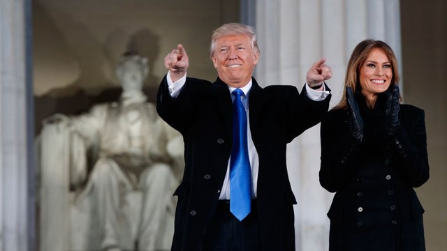 "President-elect Donald Trump, left, and his wife Melania Trump arrive to the ""Make America Great Again Welcome Concert"" at the Lincoln Memorial, Thursday, Jan. 19, 2017, in Washington. (Source: AP Photo/Evan Vucci)"