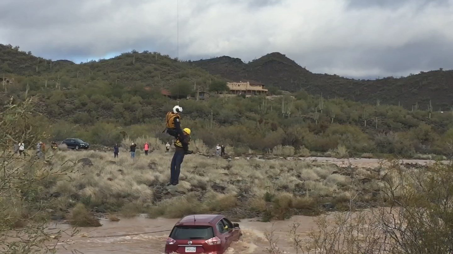 The Phoenix Fire Department used a helicopter to rescue two men from a trapped SUV on Saturday. (Source: Phoenix Fire Department)