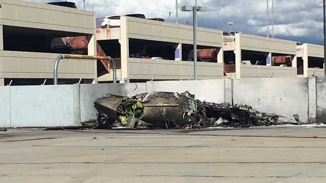 A small plane crashed into the blast wall adjacent to the parking garage. (Source: Tucson International Airport)
