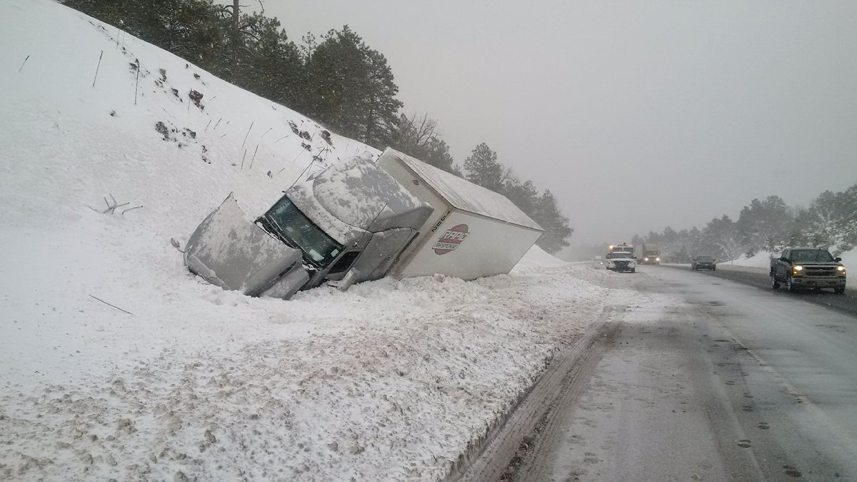 A semi-truck slid off the Interstate 40 about 20 miles west of Flagstaff. (Source: ADOT)