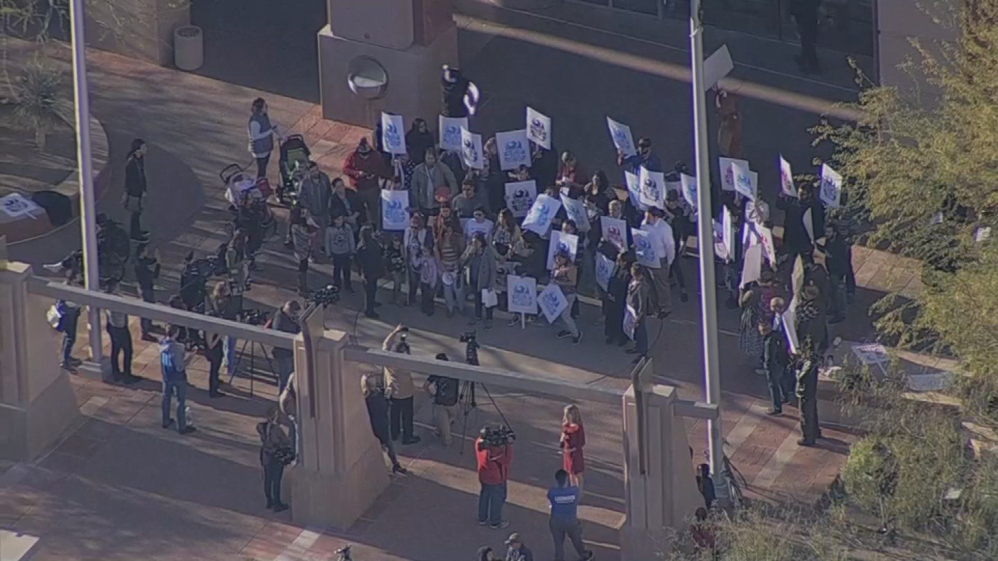 A group of people protested outside of Phoenix City Hall. (Source: 3TV/CBS 5)