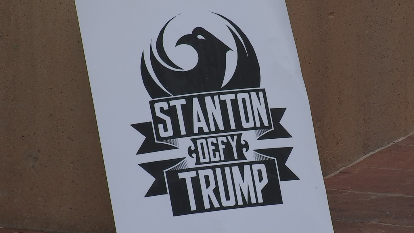 """Protesters held signs that said, """"Stanton defy Trump."""" (Source: 3TV/CBS 5)"""