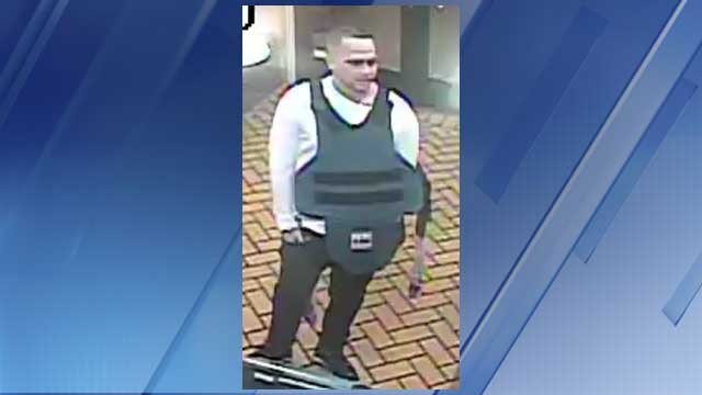 This robbery suspect wore a ballistic vest inside the IHOP near 44th Street and Thomas Road in Phoenix. (Source: Silent Witness)