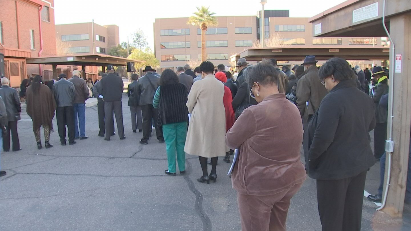 Dozens of people gathered at a historic Phoenix church on Sunday that was targeted by an arsonist. (Source: 3TV/CBS 5)