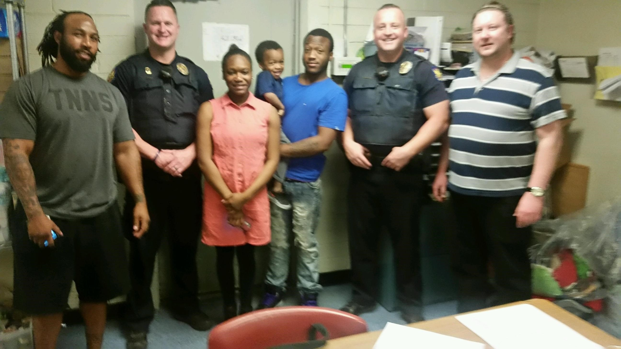 Officers Brian Wood and Josh Roper with the family at the Phoenix police station. (Source: Phoenix Police Department)