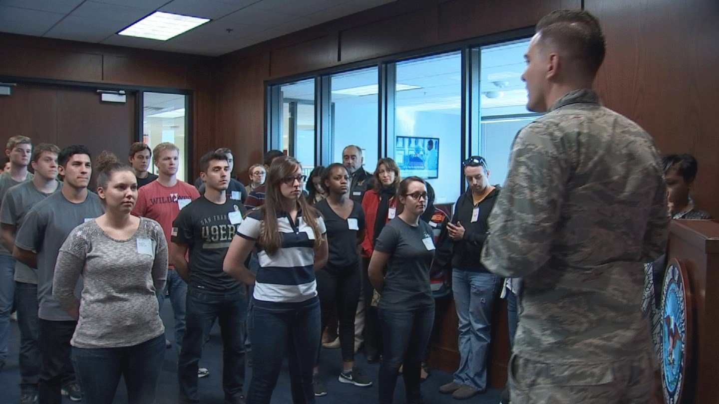 U.S. Air Force Capt. Chad Ortega-Foster talks to applicants at the Military Entrance Processing Station in Phoenix. (Source: CBS 5)