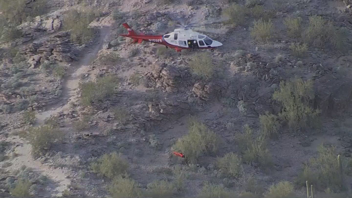 Firefighters used a helicopter to rescue a man on South Mountain. (Source: 3TV/CBS 5)