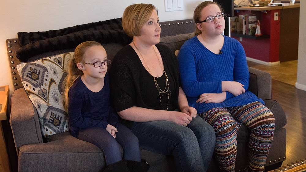 Cora Childress (left), Jennifer Childress (middle) and Caitlin Childress (right) all use Buzzies to help with anxiety. (Source: Megan Bridgeman/Cronkite News)