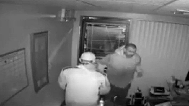 Surveillance video shows two suspects burglarizing a business called AZ Locators. (Source: Silent Witness)