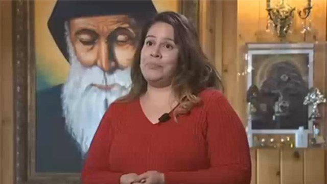 Dafne Gutierrez with an image of Saint Charbel behind her. (Source: 3TV/CBS 5)