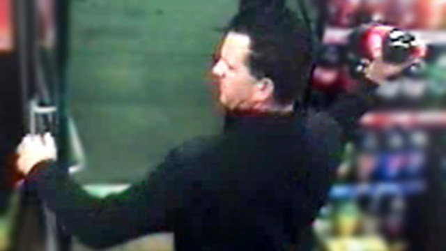 Suspect is about to throw a 2 liter soda bottle at a Circle K clerk on Jan. 1, 2017.(Source: Silent Witness)
