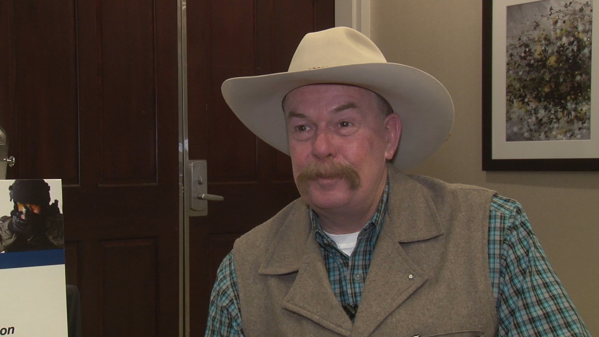 While some groups are criticizing the Trump administration's call for a border wall as costly and counterproductive, Yuma County Sheriff Leon Wilmot said the wall that went up in his county has worked well. (Source: Tyler Fingert/Cronkite News)