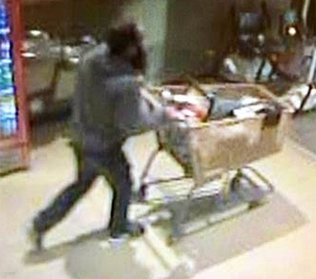 The man is seen leaving with about $700 worth of merchandise in his shopping cart.  (Source: Prescott Valley Police Department)