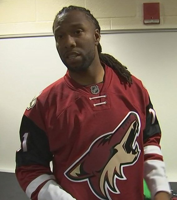 Larry Fitzgerald dons a Coyotes uniform to promote Larry Fitzgerald Night this Saturday. (Source:
