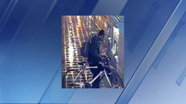 Police seek this person of interest. He is a Hispanic male wearing a gray hooded sweater and riding a white bike. (Source: Phoenix Police Department)