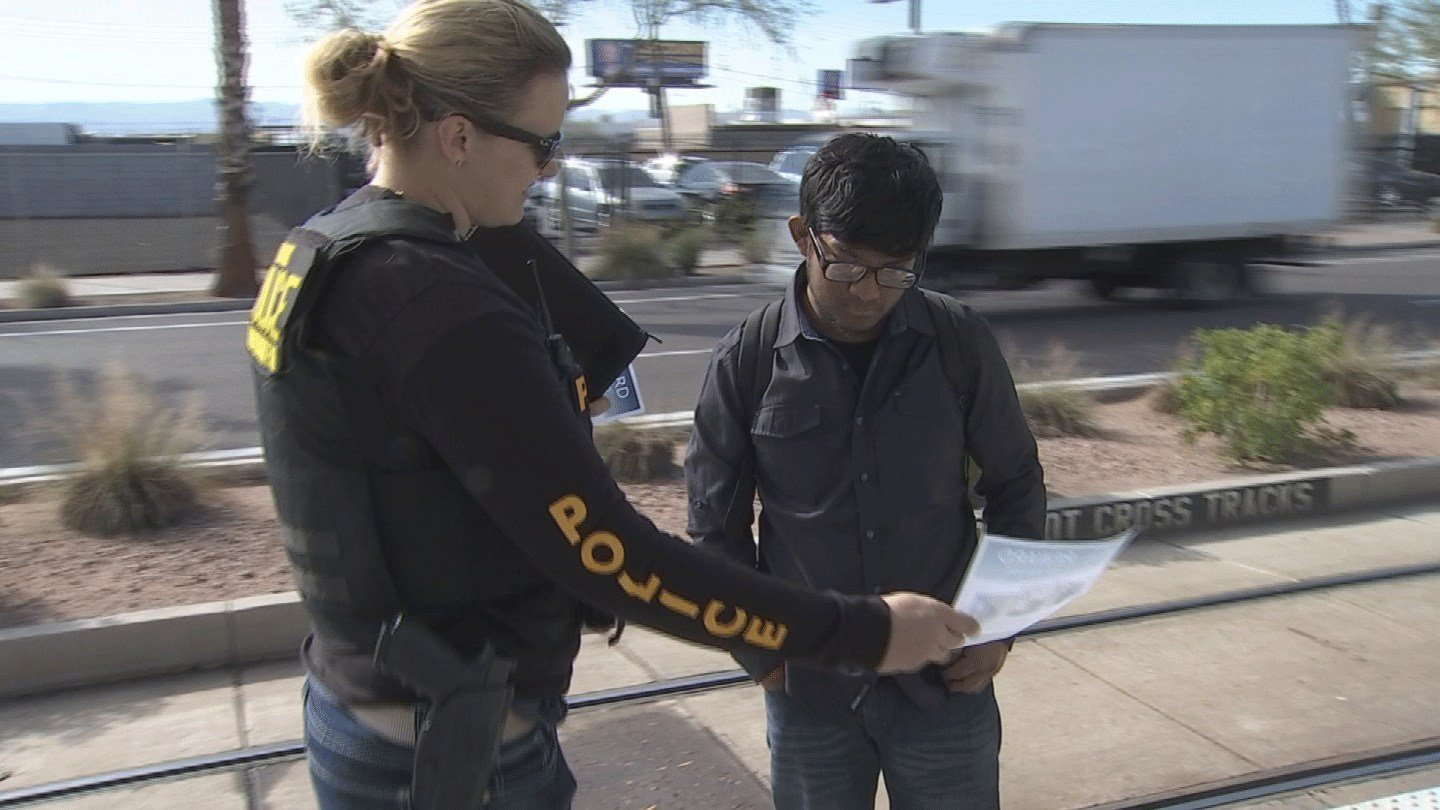 Police handed out fliers Tuesday morning. (Source: 3TV/CBS 5)