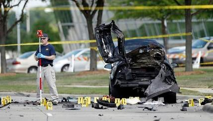 FILE - In this May 4, 2015 file photo, FBI crime scene investigators document evidence outside the Curtis Culwell Center in Garland, Texas.