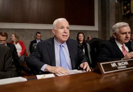 Sen. John McCain, R-Ariz., joined at right by the committee's ranking member, Sen. Jack Reed, D-R.I., speaks on Capitol Hill in Washington, Thursday, Feb. 9, 2017. (Source: AP Photo/J. Scott Applewhite)