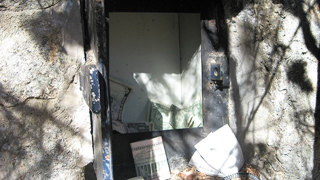 The donation box was accessed on the back side of the stone wall. (Source: Yavapai County Sheriff's Office)