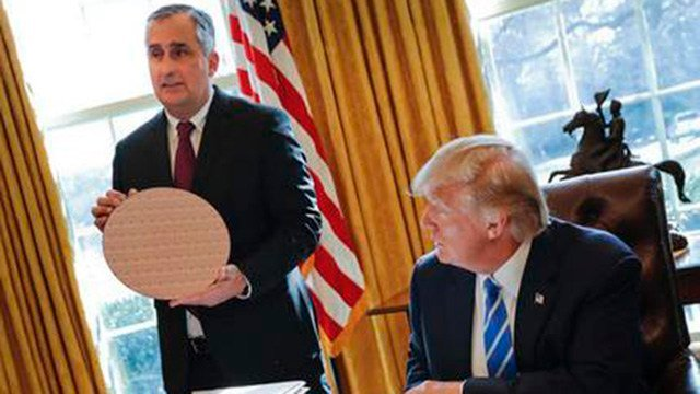 President Donald Trump looks at Intel CEO Brian Krzanich, holding a silicon wafer, during their meeting in the Oval Office of the White House in Washington, Wednesday, Feb. 8, 2017. (AP Photo/Pablo Martinez Monsivais)