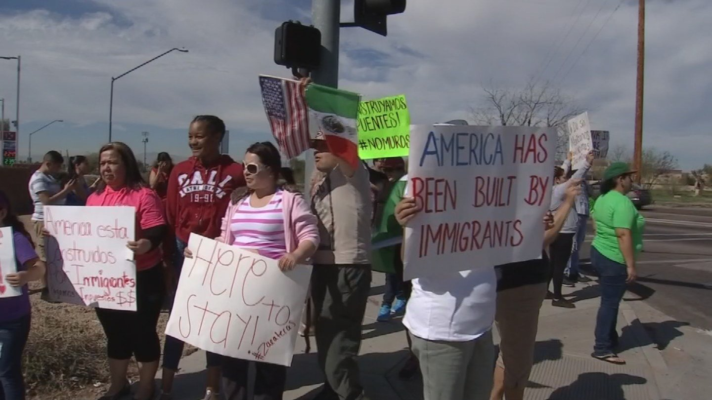 Demonstrators held signs and chanted on the corner of 91st Avenue and Camelback Road on Thursday. (Source: 3TV/CBS 5)