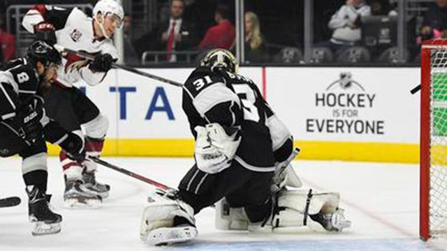 Arizona Coyotes left wing Brendan Perlini, (center) scores on Los Angeles Kings goalie Peter Budaj (right), as defenseman Drew Doughty tries to defend on Thursday, Feb. 16, 2017 in L.A. (Source: AP Photo/Mark J. Terrill)