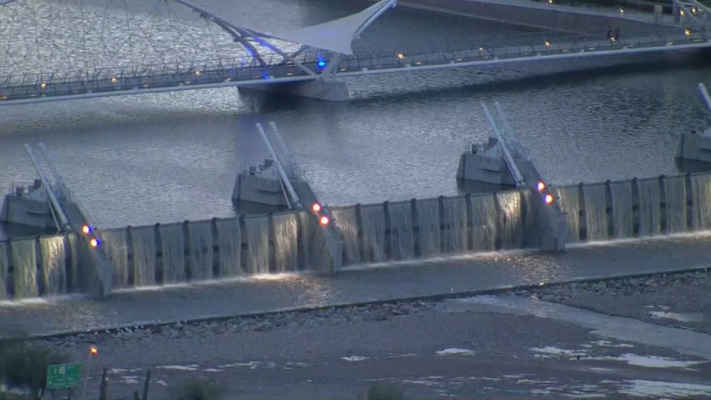 Aerial view of water flowing over the dam at Tempe Town Lake on Friday, Feb. 17. (Source: KPHO/KTVK)