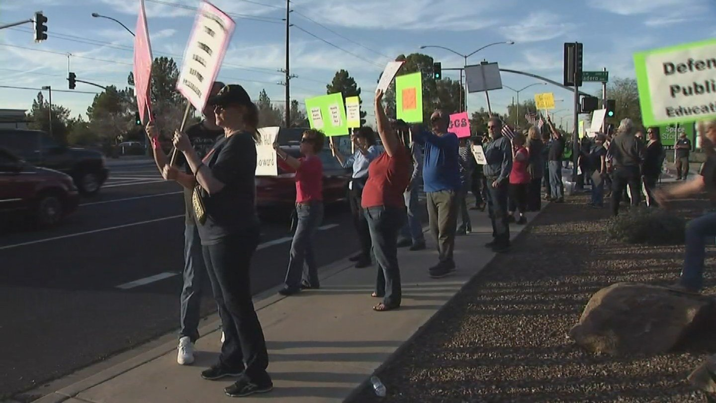 Dozens of protesters gathered outside of Rep. Andy Biggs' office in Mesa, demanding a town hall. (Source: 3TV/CBS 5)