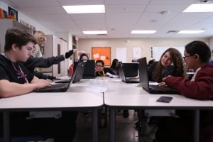 Students in this Phoenix Coding Academy history class are searching the web for current events. The academy specializes in computer science. (Source: Christopher Silavong/Cronkite News)