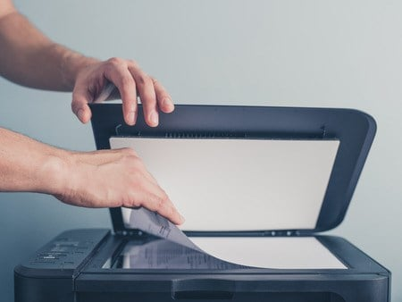 Cheap flatbed scanners that require you to manually place each page on the scanner won't do the trick if you're going paperless. (Source: loganban via 123RF)