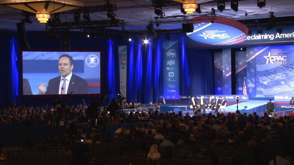 Kentucky Gov. Matt Bevin, on the screen, was one of four Republican governors, with Arizona Gov. Doug Ducey, on a panel at the Conservative Political Action Committee meeting. (Source: Ziyi Zeng/Cronkite News)