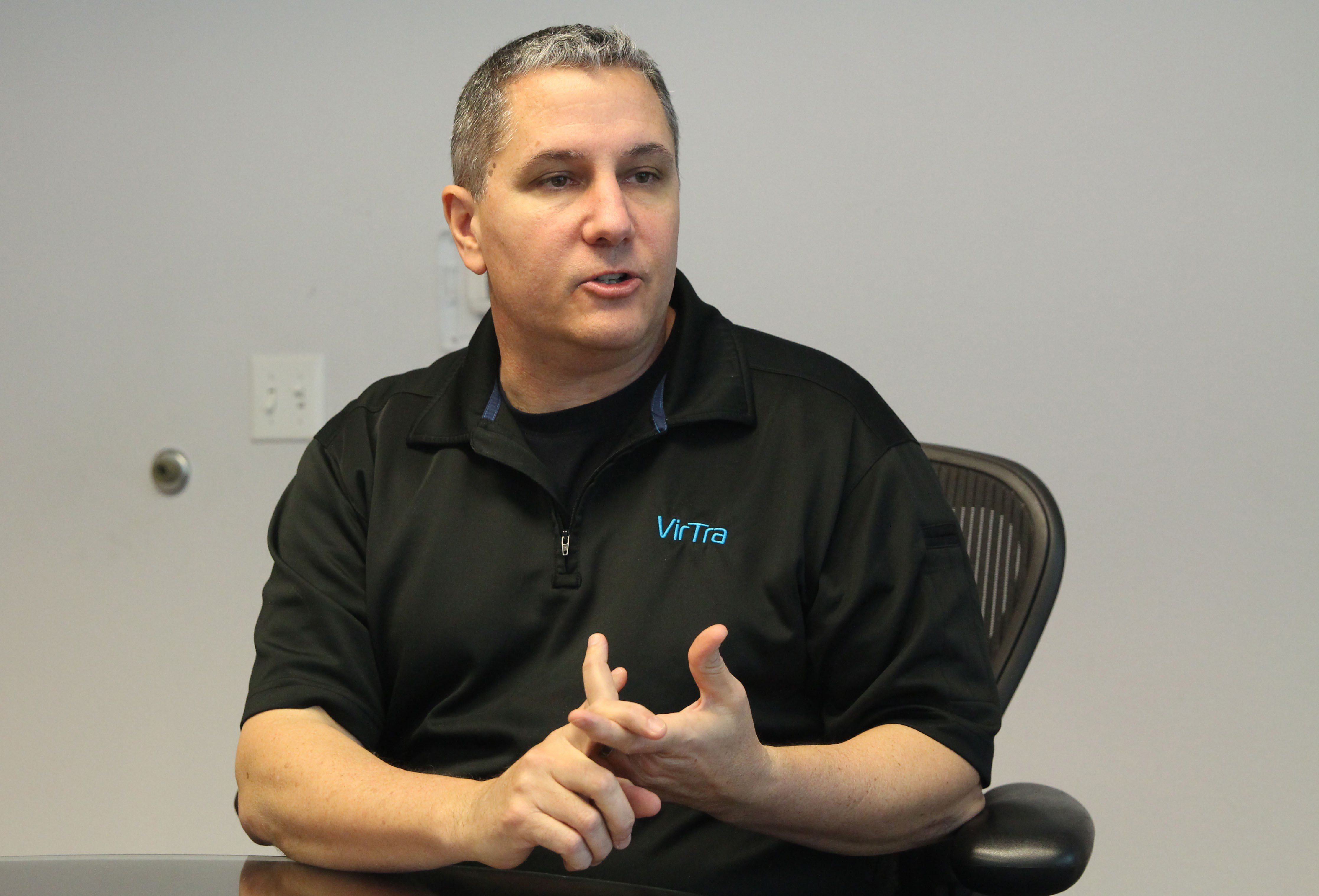 Scott Dilullo, federal law enforcement business development manager at VirTra, said competitors are just now starting to incorporate multiple screens. (Source: Megan Bridgeman/Cronkite News)