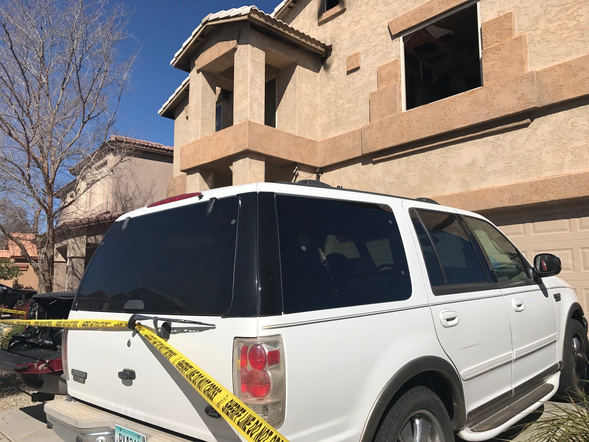 Crime tape secured the Queen Creek home as the investigation began. (Source: Karla Navarrete, 3TV/CBS 5))