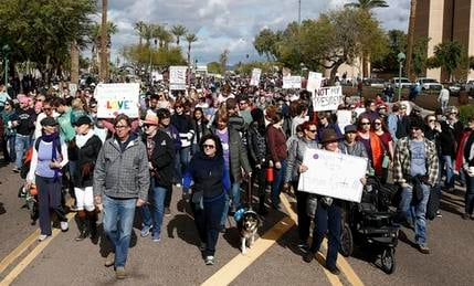FILE - In this Jan. 21, 2017, file photo, thousands of demonstrators march in Phoenix in support of those in cities around the globe protesting against Donald Trump as the new United States president. (AP Photo/Ross D. Franklin, File)