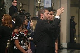 Rep. Ruben Gallego, D-Phoenix, points out detail in the Capitol to Jacqueline and Angel Garcia De Rayos, guests for President Donald Trump;s speech whose mother was deported this month. (Source: Cronkite News)