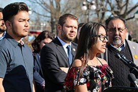 Angel Garcia de Rayos, left, and his sister, Jacqueline, speak at the Capitol about their mother, who was deported this month. (Source: Dustin Quiroz/ Cronkite News)
